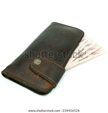 brown leather wallet with money isolated on white background