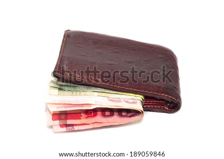 Brown leather wallet with Thai bath bills on white background