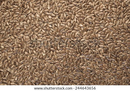 brown linseeds close up background