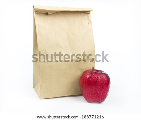 Brown Lunch bag paper with red apple on white background - stock photo