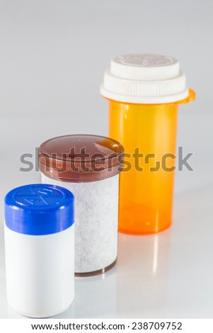 Brown medicine bottle placed in the middle.