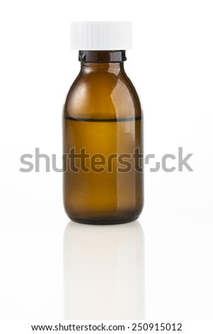 Brown medicine bottle with liquid inside and white top. - stock photo