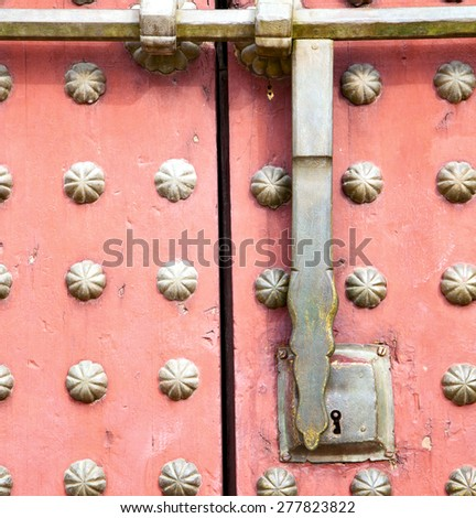 brown    morocco in    africa the old wood  facade home and rusty safe padlock  - stock photo