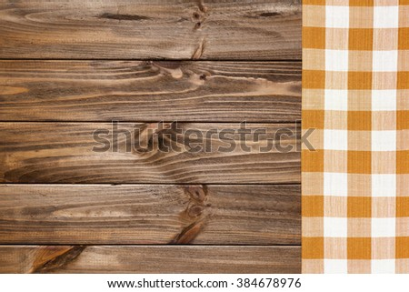 Brown napkin on the old wooden table. - stock photo