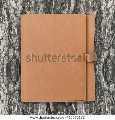 Brown notebook with cover background on vintage tree bark pattern and texture.