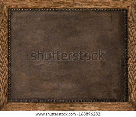 brown old leather frame with upholstery nails