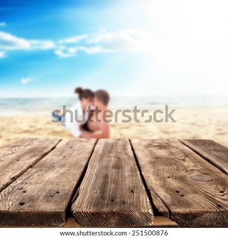 brown old table place and lovers on sand and beach landscape  - stock photo