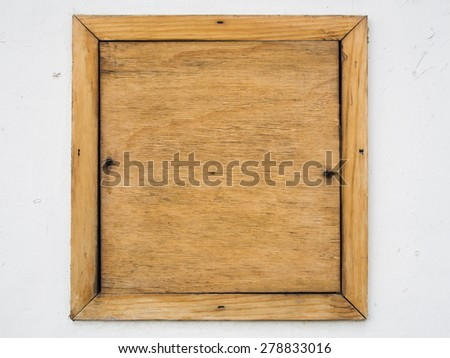 Brown old wood board on white cement wall background - stock photo