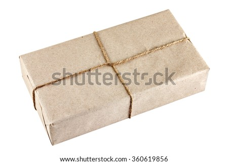 Brown package tied with a rope isolated on white
