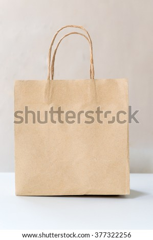 brown paper bag on  white table
