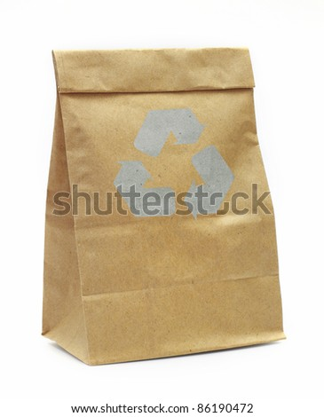Brown paper bag with recycle sign isolated over white background - stock photo