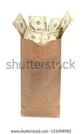 Brown paper bag with United States twenty dollar bills coming out of it for concepts money laundering,c rime, drug dealing, mafia, bribe payoffs, cash business - stock photo