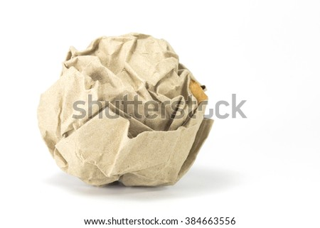 brown paper balls on gray background selective focus with shallow depth of field