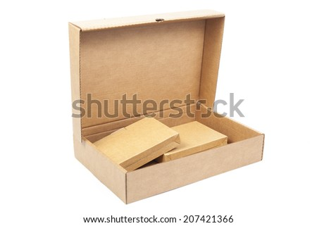Brown paper box open. Inside, there are two small boxes.on white isolated background.