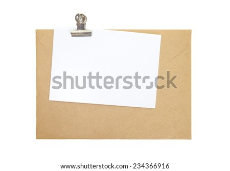 Brown paper envelope with blank white note paper and clip   - stock photo