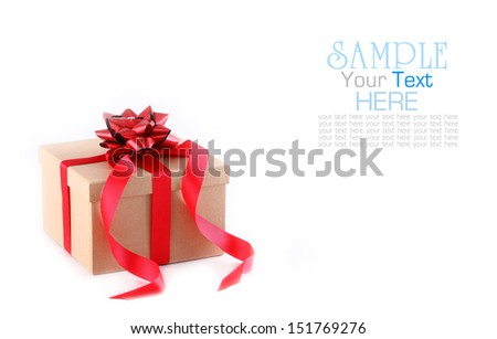 Brown paper gift box with red ribbon bow, isolated on white  - stock photo