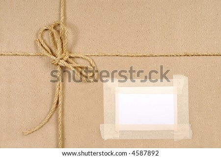 Brown paper parcel background, address label