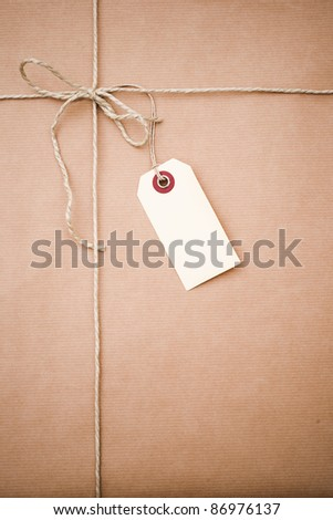 brown paper parcel with copy space - stock photo