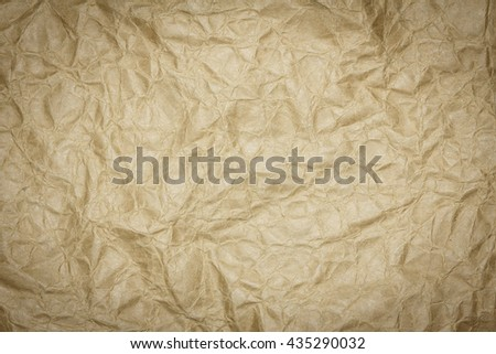 Brown paper sheet. Closeup brown recycled crumpled paper texture. Brown recycled crumpled paper background with copy space for text or image. Dark edged. - stock photo