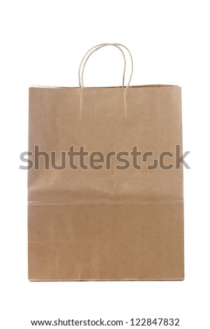 Brown paper shopping bag displayed on white. - stock photo
