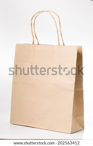 Brown paper shopping bag isolated with white background