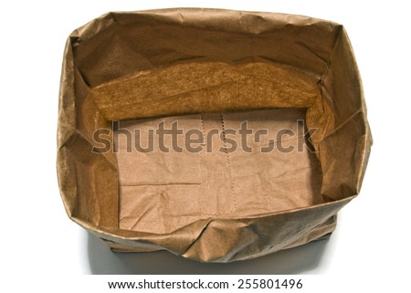 Brown Paper Shopping Bag Shot From Above Isolated On White Background - stock photo