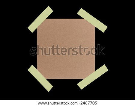 Brown paper with masking tape on the corners. - stock photo