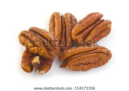 Brown pecans isolated on a white background.  - stock photo