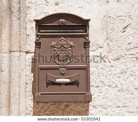 Brown Post box on wall. - stock photo