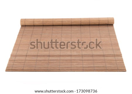Brown reed rug on a white background