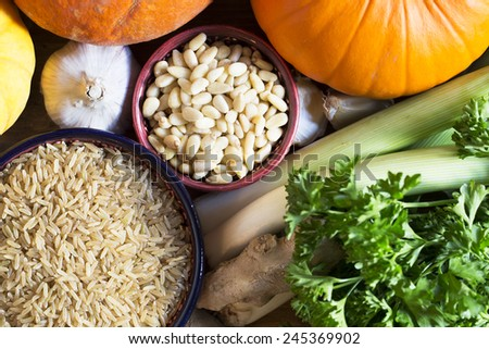 Brown rice and pine nuts other ingredients, healthy eating still life - stock photo