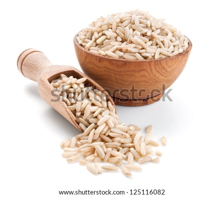 brown rice in a wooden bowl isolated on white background - stock photo