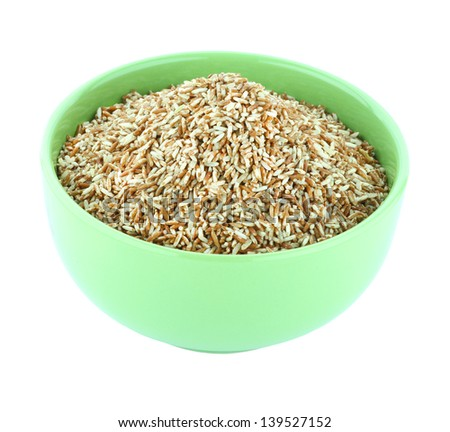 Brown rice in green bowl isolated on white background