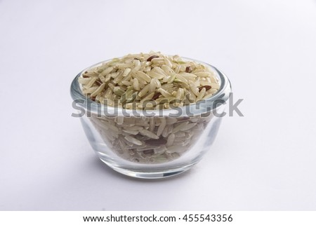 brown rice mixed in glass bowl - stock photo