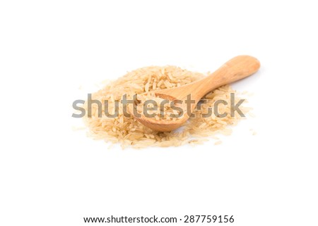 brown rice over the spoon on a white background - stock photo