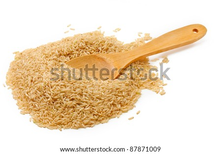 brown rice over the spoon on white background - stock photo