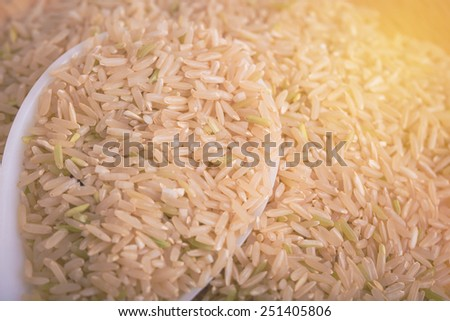 Brown rice. Vintage filter. - stock photo