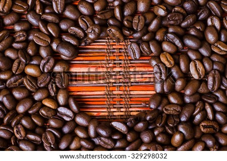 Brown roasted coffee beans, seed on red background with copy space. Espresso dark, aroma, black caffeine drink. Closeup isolated energy mocha, cappuccino ingredient.  - stock photo
