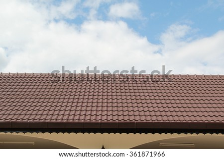 Brown roof tiles with blue sky background. - stock photo