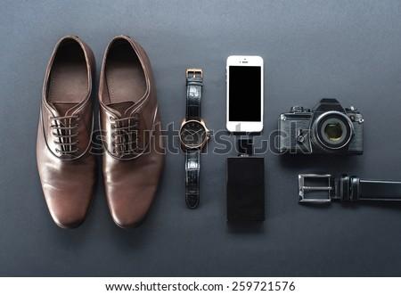 brown shoes, film camera, telephone, clock, parfume - stock photo