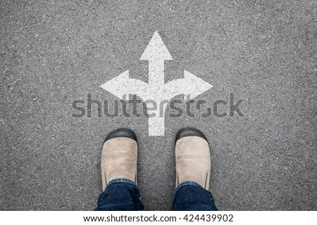 Brown shoes standing at the cross road making decision which way to go. Three ways to choose