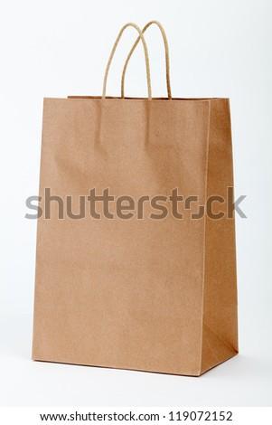 Brown shopping bag on white. - stock photo