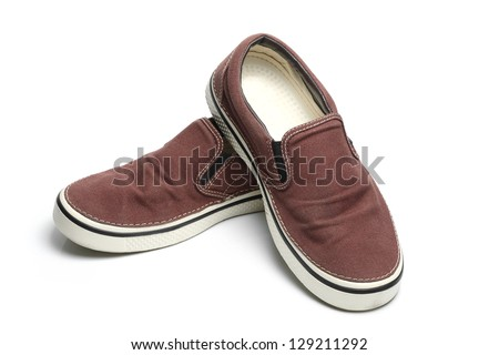 brown slip-on casual shoes over a white background. - stock photo