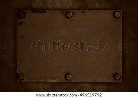 brown steel plate with screws or abstract metal background