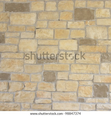 brown stone wall detail background. - stock photo