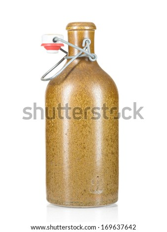 brown stoneware bottle isolated on white - stock photo
