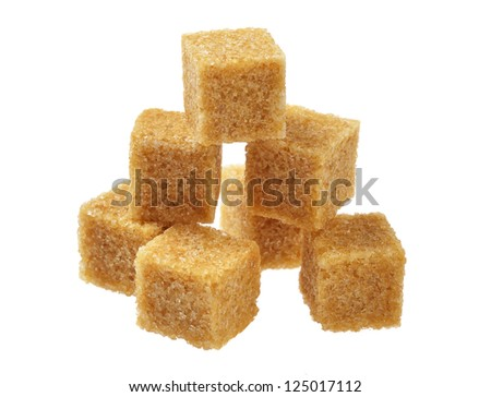 Brown sugar, a few pieces. Isolated on white. - stock photo