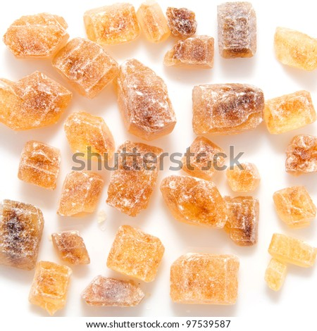Brown sugar cane. Large chunks. Isolated on white background with clipping path Background or texture - stock photo