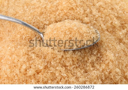 brown sugar heap and wooden spoon