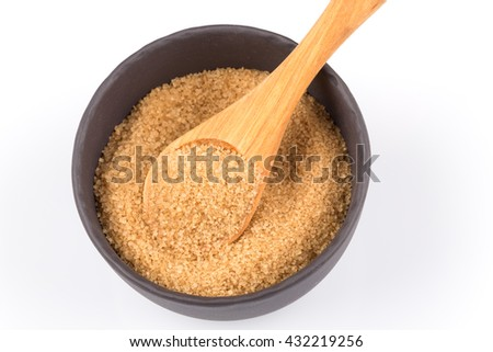 brown sugar in a dark bowl with wooden spoon  isolated on white - stock photo